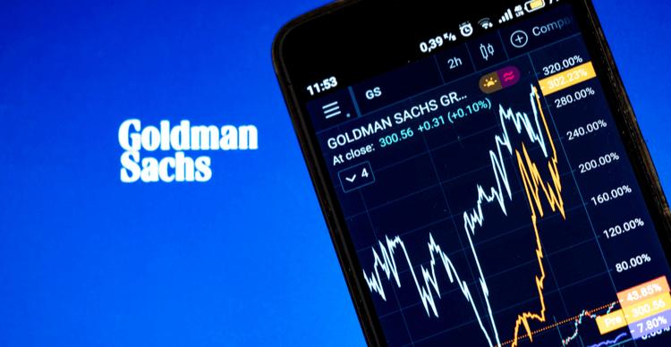 Het logo van Goldman Sachs met een aandelengrafiek